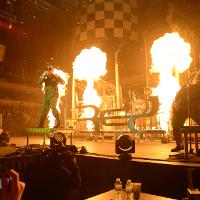 artist performing with pyro