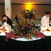 two caterers serving food