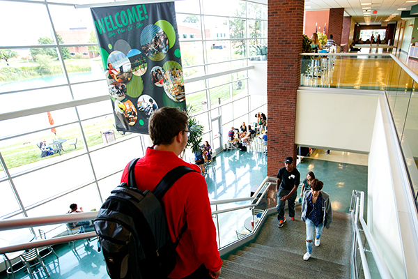 Students on the stairs at the Student Center, on thier way to visit Eastern Michigan University Office of Admissions