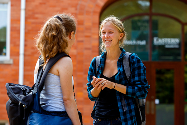 Students converse outside Welch Hall