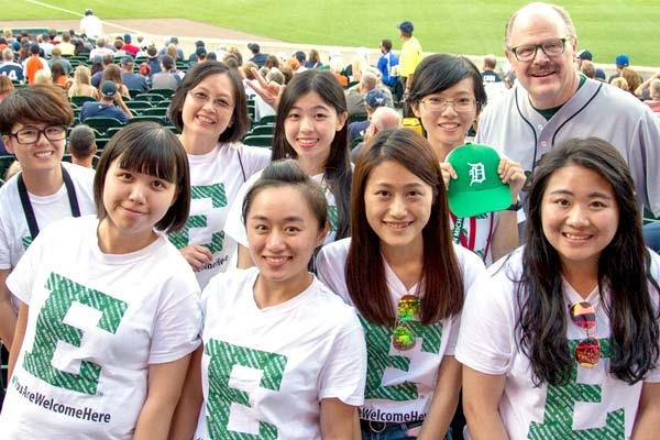 International students at a Detroit baseball game with the president.