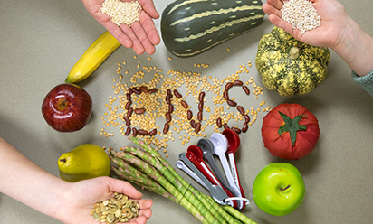A photo of veggies and beans spelling out ENS.