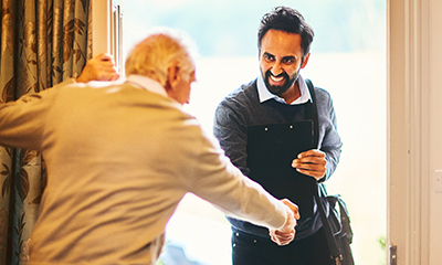 Field Placement Info social worker greeting man at door