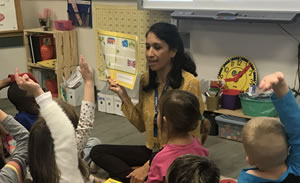 A photo of Brenda Gonzalez reading to her class