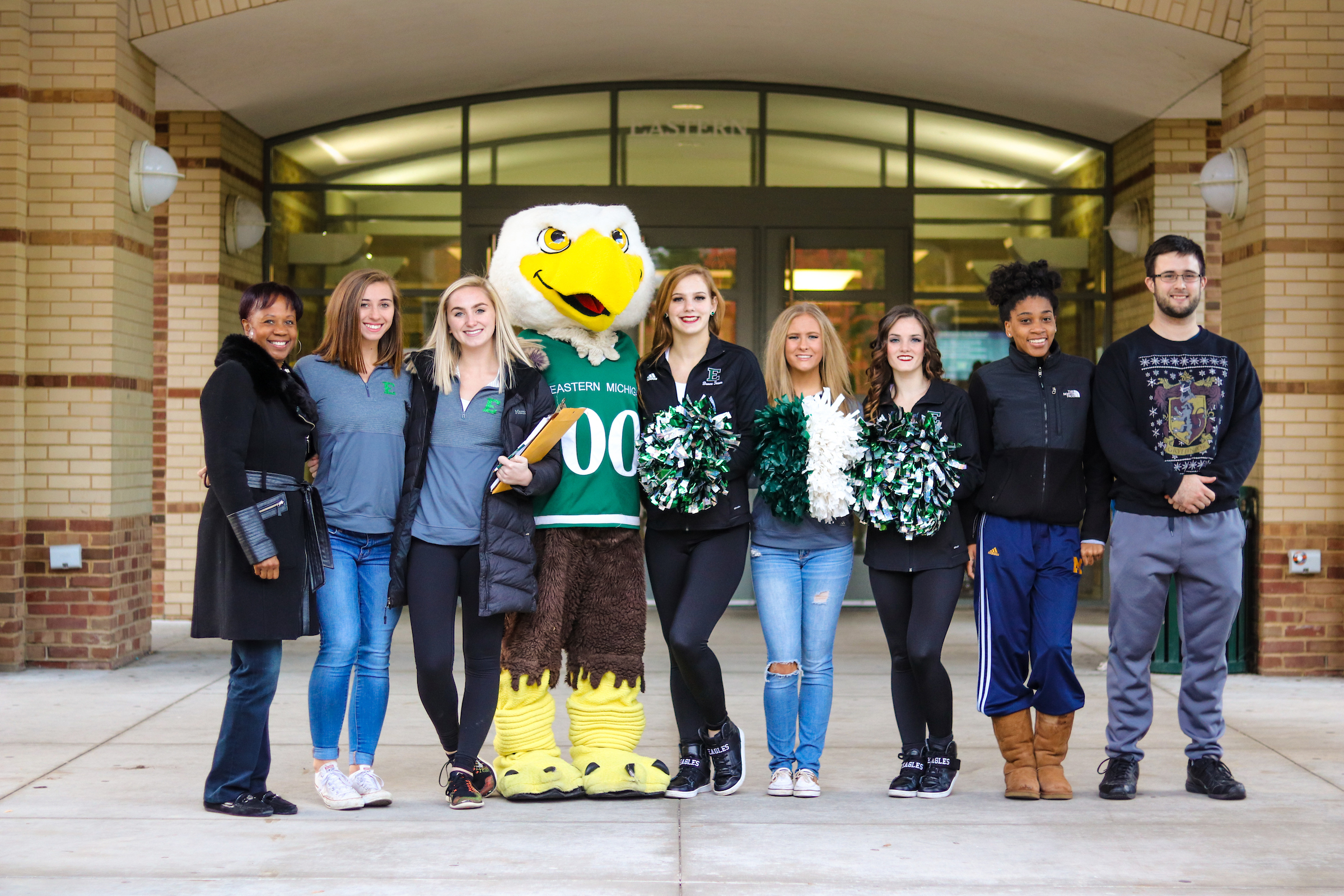 A photo of PR students standing with the EMU mascot, Swoop.