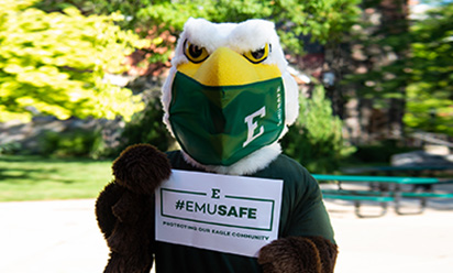 swoop mascot wearing face covering and holding emusafe sign