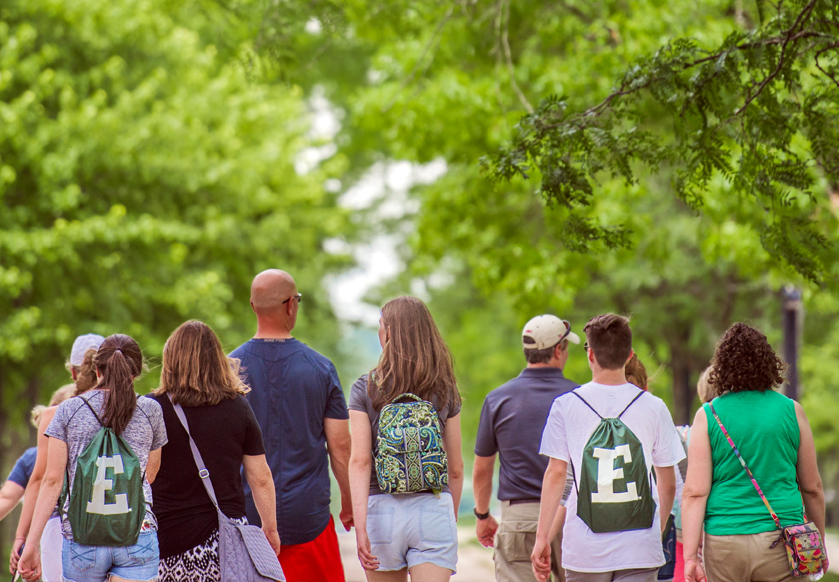 A group of people walk across campus at one of the best universities in Michigan.