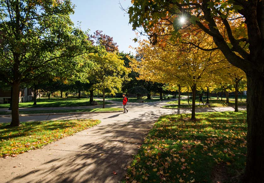 A student walks on campus at one of the best universities in Michigan.