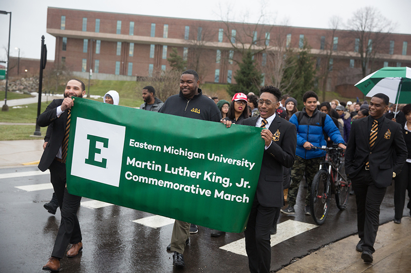 Students lead the commemorative march across campus.