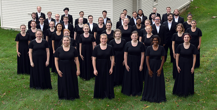 EMU Choir poses outside in formal attire.