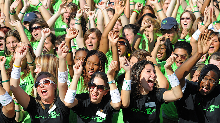 EMU students cheering at an event.